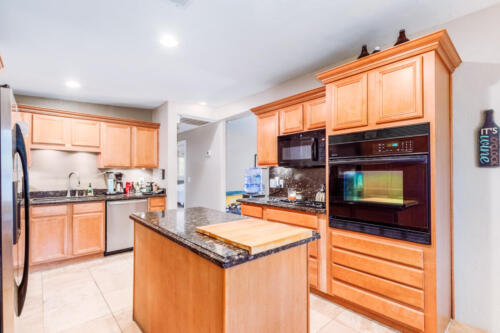 Updated Kitchen with Gas Range, Granite Countertops & Tons of Storage.