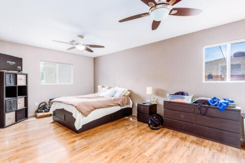 Large Master Bedroom with New Laminate Flooring