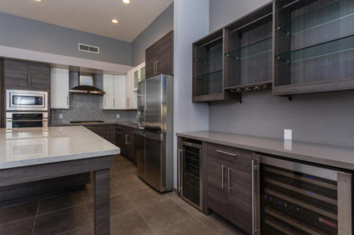 Chefs Kitchen with Gas Range, Quartz Countertops & Built-in Bar with 2 Wine Fridges