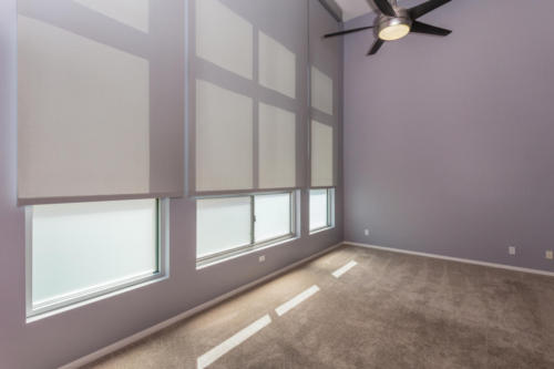 Large Master Bedroom with Floor to Ceiling windows with remote controlled shades
